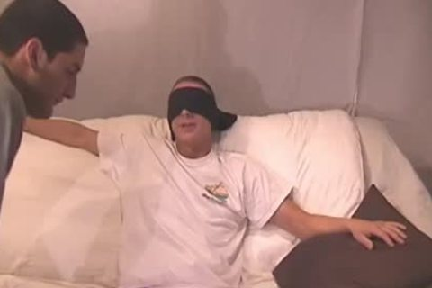 Blindfolded twink acquires His penis Sucked